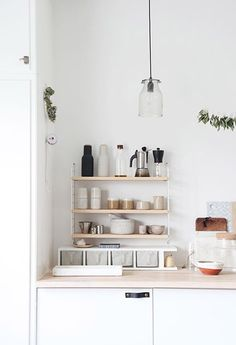 tiny open shelves in white kitchen with light wood countertops / sfgirlbybay
