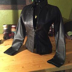 Genuine leather jacket So sexy! Wish it still fit me. Size small made by rampage / has 3 clasps in front to close jacket Rampage Jackets & Coats