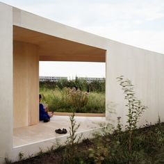 Dutch architect Anne Holtrop has completed a pavilion in an overgrown field in Almere, Netherlands, with plans that follow existing trails and paths across the site.