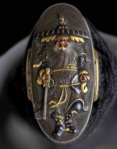 Wakizashi - Shoki Kashira Closeup - Dated: 17th century (Edo Period) Steel, gold, copper and gold alloy