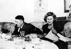 This undated file picture shows the German Fuehrer Adolf Hitler and his mistress Eva Braun while dining.