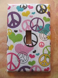 Cute peace sign light switch plate / cover - Perfect for your little girl's room. $7.99, via Etsy.
