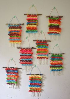 Kids dye their own chunky wool yarn with Koolaid, then make small weaving on cardboard looms. Kids dye their own chunky wool yarn with Koolaid, then make small weaving on cardboard looms.