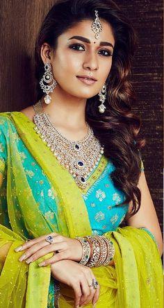 South indian actress Nayanthara in GRT Diamond Jewelry.Bridal big diamond necklace with pearl drops,long diamond earrings,diamond maang tikka,diamond rings and diamond bangles all studded with precious emeralds. South Indian Actress, Beautiful Indian Actress, Sonam Kapoor, Deepika Padukone, Indian Wedding Jewelry, Indian Beauty Saree, India Beauty, Indian Girls, Indian Wear