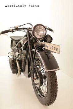 according to the front fender it's a 1928 BMW. Note that the cylinders are at a 90 degree angle, flat-twin engine design.