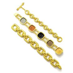 Gold bracelets by Elizabeth Locke.