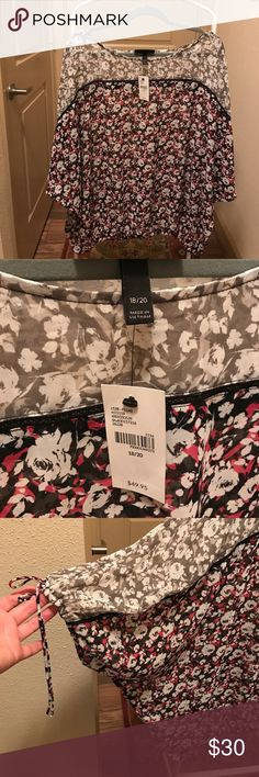 NWT Lane Bryant elasticated peasant blouse Size 18/20 NWT 3/4 length sleeves and elasticated waist peasant blouse. Main panels in black/red and white flowers. Top part of blouse in same pattern but grey with white flowers. On trend with the floral theme for this season. Pretty ties at end of sleeves. Not worn as decided I did not like the elasticated waist on me. Lane Bryant Tops Blouses