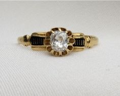 This is the sweetest antique old European cut diamond engagement ring with beautiful enamel accents.
