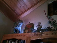 Bookcase decor in living room - I am still working on the  French Country style look