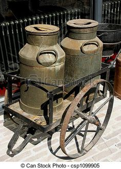 Photo about Old wheelbarrow carrying two old milk cans. Image of farm, barn, jugs - 2517375