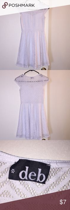 Short White Dress I bought this dress for my sorority initiation and wore it maybe 3 times. It has a built in slip. Deb Dresses Mini