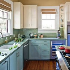top and bottom cabinets painted differently (cream top and ?? bottom, plus another color for an island)     Austin Green Renovation colorful kitchen from best toh tv home remodels by kevin o'connor