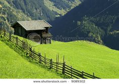An old fence and a stable in the Alps