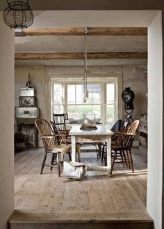 Exposed beams, eclectic furniture, minimalist kitchen