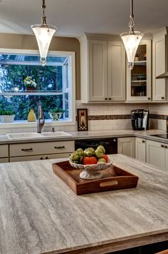 Bothell Kitchen Remodel by Provanti Designs, Inc Kitchen & Bath Designers with a Formica 180fx® Travertine Silver island