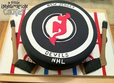 New Jersey Devils Hockey Puck Cake by A Little Imagination Cakes, via Flickr