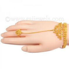 yellow gold hand chain bracelet, popularly known as Hath punja, designed with a hand chain of 3 inches in length from the bracelet to the ring (center motif mm). The wrist bracelet chain is inches in length inches). The ring Chain Jewelry, Gold Jewelry, Jewelery, Woman In Gold, Slave Bracelet, Hand Chain, Gold Bracelets, Gold Hands, Jewellery Designs
