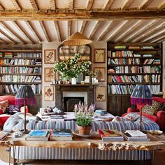 Richly coloured and inviting sitting room. Bookshelves always make a room so welcoming.