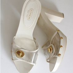 Coach Cagney wood clogs heels Coach slip on white/clear wood heel.  A real classy shoe  size 10, runs SMALL like an 8.5 or 9, mainly narrow at the toes.   worn  once. Chip on one shoe as shown in pic. Clogs mules Coach Shoes Mules & Clogs