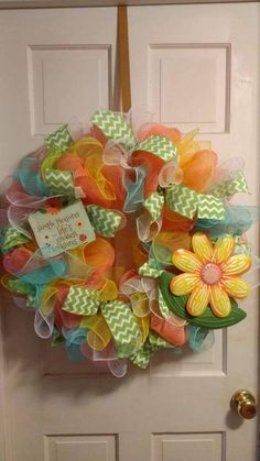 This is a handmade one of a kind deco mesh wreath. Created using peach deco mesh, yellow deco mesh, white deco mesh, teal deco mesh, and lime green Chevron ribbon. Accented with sign simple pleasures.... Lifes greatest treasures measuring 5 inches tall and 5.5 inches wide, and with large metal flower measuring 10 X10. Finished product is approximately 24 inches in diameter and 8 inches thick. Would look great displayed inside or out!! Perfect for spring and to welcome the warmer weather…