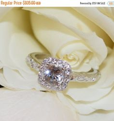 ON SALE Diamond Engagement ring, Natural White Sapphire Ring, Diamond alternative ring, leaves and vines rustic ring, Cushion halo ring by BridalRings on Etsy https://www.etsy.com/listing/398054071/on-sale-diamond-engagement-ring-natural