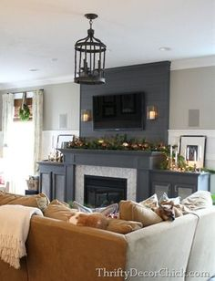 v5 - lots of this one from different angles.  like the drop from the mantel to the side cabinets.  do not prefer gray or planks - would prefer stone and cherry color/or another wood - i LOVE this mantel!