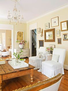 Gold frames form a pretty gallery wall that dresses up this living room: http://www.bhg.com/decorating/decorating-photos/living-room/delightful-display/?socsrc=bhgpin013015delightfuldisplay&living-room