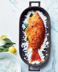 Brushing a whole red snapper with smoky paprika gives it terrific flavor; packing it in salt during roasting keeps it supermoist.