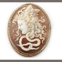 A seed pearl and gold medusa cameo brooch