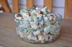 Amish Broccoli Salad... This is to die for...  1 head broccoli, chopped 1 head cauliflower, chopped 1 cup mayonnaise 1 cup sour cream 1/2 cup sugar 1/2 teaspoon salt 1/2 pound bacon, fried and crumbled 1 cup shredded Cheddar cheese