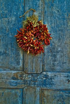 Red chili wreath on blue door - Santa Fe, NM