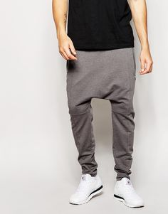 "Joggers by ASOS Loop-back sweat Drawstring waistband Zipped side pockets Patch pocket to reverse Drop crotch fit Machine wash 63% Cotton, 37% Polyester Our model wears a 32""/81cm regular and is 188cm/6'2"" tall"