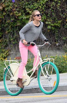 Kristen Bell rides a bike.