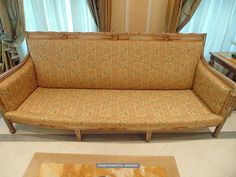 Lot 518 - Italian Neoclassical style Painted & Parcel Gilt The back rest with panelled top rail decorated with