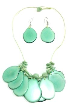 Selvatica on mint tagua nut slices necklaces with earrings