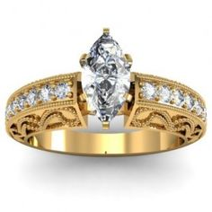 Marquise Milgrain Vintage Diamond Engagement Ring - Here comes a classy style shank with this 14k Yellow Gold Marquise Milgrain Vintage Diamond Engagement Ring placed in a Pave setting featuring a White Marquise cut center stone with 16 Round cut accent stones on the custom Milgrain style shank. The Marquise Milgrain Vintage engagement ring comes with a VS1 in clarity as well as an E in color. The total gem weight is equal to .70 carats. The diamonds are 100% natural. #unusualengagementrings