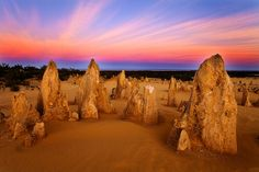 Formed over millions of years, thousands of tall limestone spires rise eerily out of the yellow desert sands of Nambung National Park - Pinnacle Desert, Western Australia