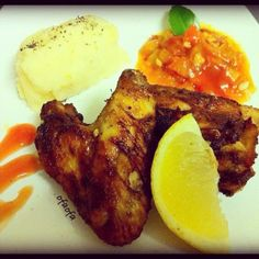 Homade spicy wings with tomato salsa n cheese mashed potato..