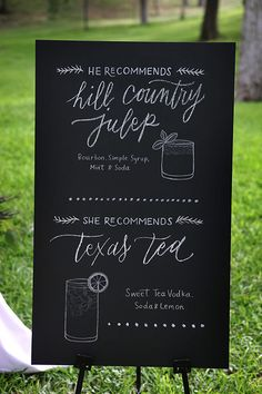 A chalkboard sign that spells out the bride and groom's favorite cocktails | Brides.com