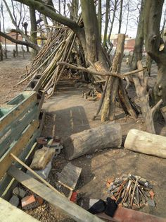 Adventure play with pallets and branches as loose parts, - on the boundary of the schoolground. Leaning up to trees in a green belt. Palettskolan primary school Lund - Skåne - South-Sweden.