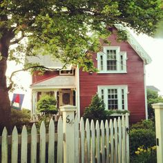 pink house, white picket fence