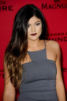 Kylie Jenner vamps it up in grey midi dress and dark plum lip at Catching Fire premiere - Kylie Jenner images - sugarscape.com