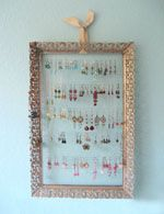 DIY instructions for an earring display using a thrifted frame, wire & a bit of ribbon. so creative!