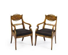 A pair of Russian Neoclassical parcel gilt walnut armchairs first half 19th century