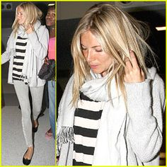 Sienna Miller in light-blue skinny jeans, striped top, light blue-gray cardigan, scarf, and black flats.