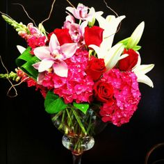 Spring floral arrangement with bright raspberry colored hydrangeas by Robyn