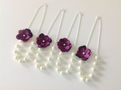 4 Bridesmaid Gift Set - Purple Flower Necklaces - 4 Pearl Bridesmaid Sets - Pearl Flower Necklace - Wedding Party Jewelry - Hydrangea purple. $108.00, via Etsy.