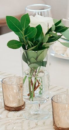 30: Pedestal Cylinders with simple greens and a rose