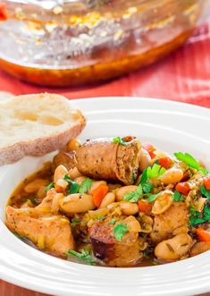 Classic French Cassoulet - a classic and simple yet delicious casserole with beans, pork sausage and chicken breast. Serve this with a french baguette and salad.