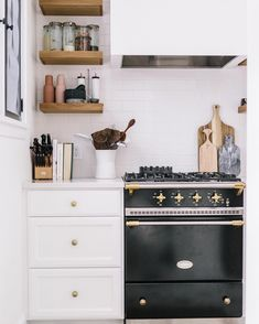 11 Shortcuts That Make Cleaning Your Home So Much Easier | The Everygirl Beautiful Kitchen Designs, Beautiful Kitchens, Kitchen Shelves, Kitchen Dining, Kitchen Wood, Wood Shelves, Kitchen Storage, Kitchen Countertops, Kitchen Cabinets